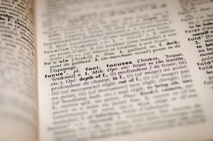 Page from a dictionary to represent proofreading services for businesses and academics