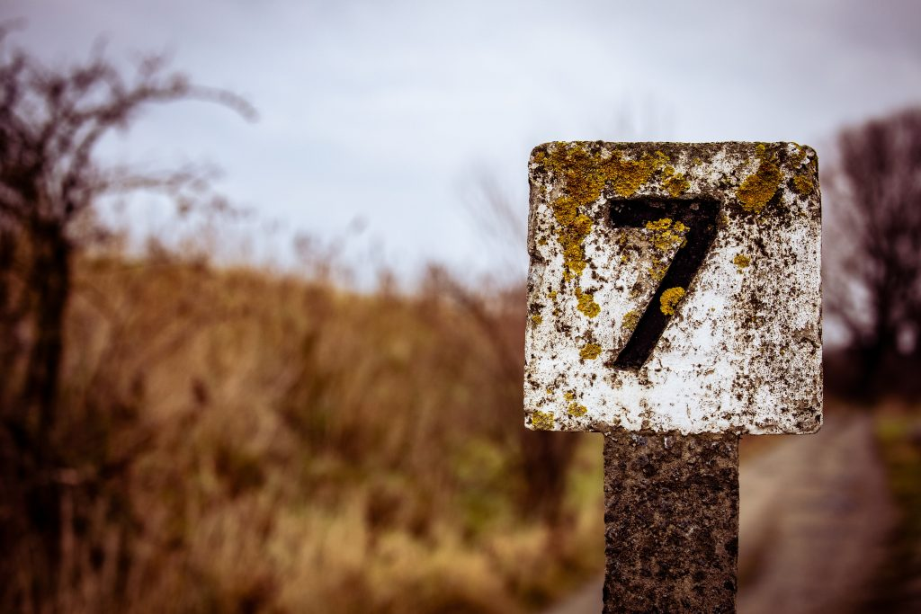 The number seven on a signpost